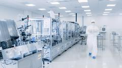 stock-photo-shot-of-sterile-pharmaceutical-manufacturing-laboratory-where-scientists-in-protective-coverall-s-1268263645